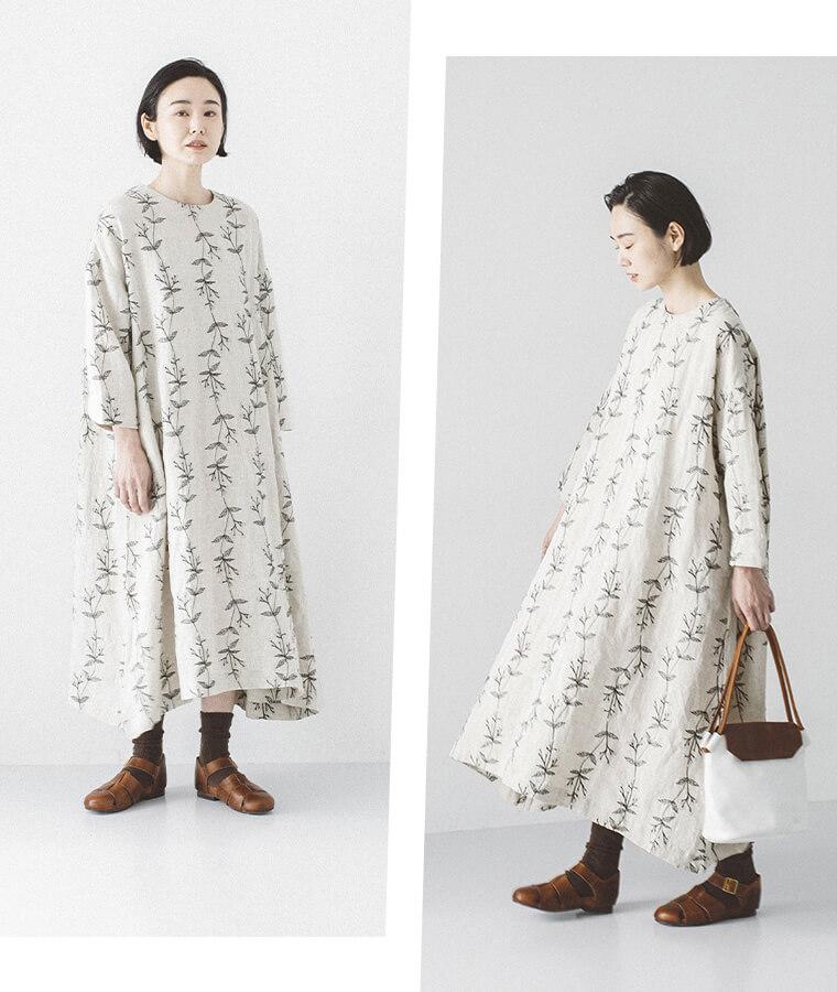 ボタニカル刺しゅうワンピースを着た女性