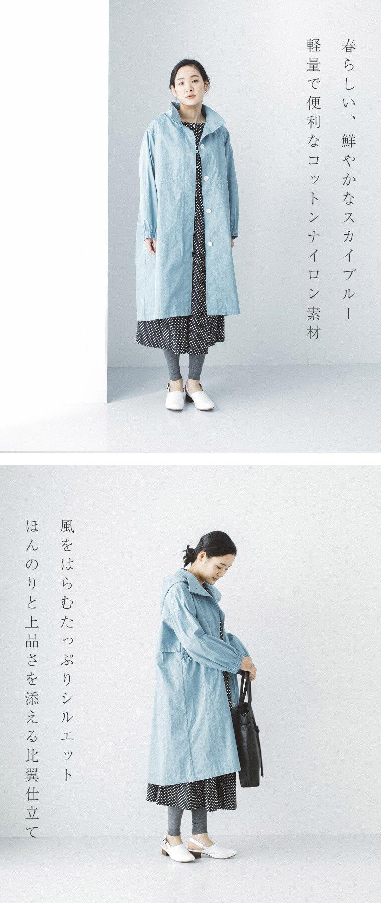 タイプライターマウンテンコートを着た女性