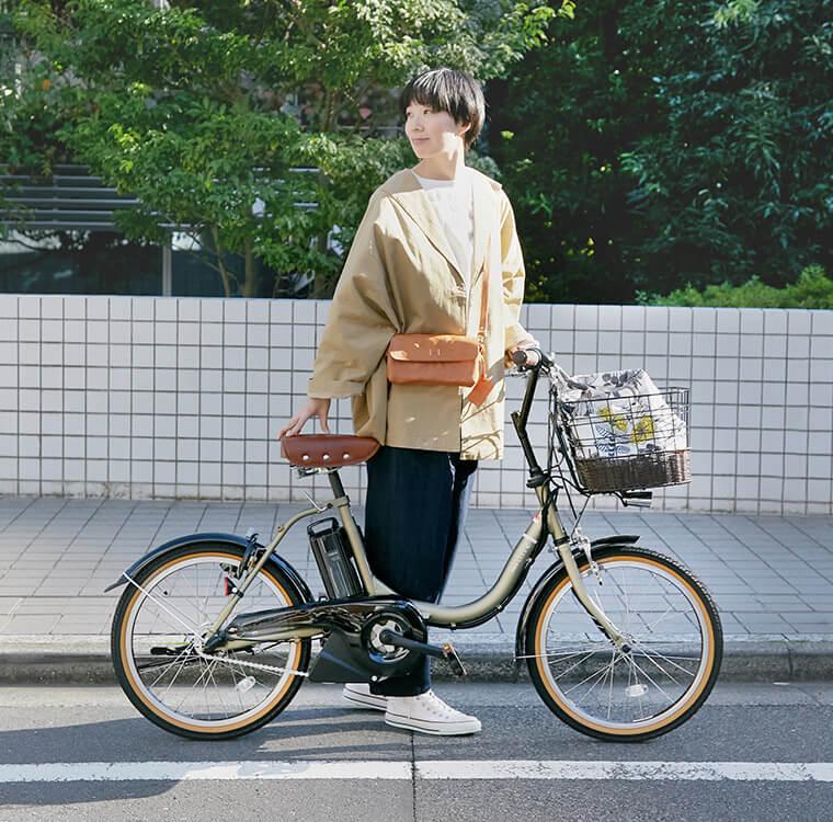 YAMAHAのPAS CITY-Cの電動自転車と女性
